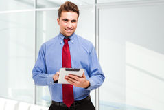 Business man using his tablet Royalty Free Stock Photos