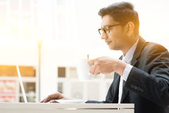 Business man using internet at cafe Royalty Free Stock Photos