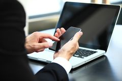 Business man using internet on smart phone and laptop. Business man using internet on smart phone and laptop Stock Photos