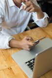 business man using internet on smart phone and laptop. Stock Images
