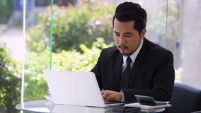 Business man using laptop computer. Young business man using laptop computer stock footage