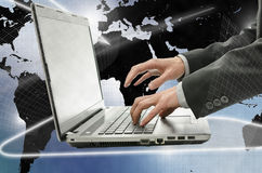 Business man using laptop in interactive space Stock Images