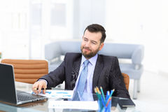 Business man using laptop and modern devices in office Stock Images