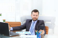 Business man using laptop and modern devices in office Royalty Free Stock Photos