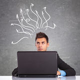 Business man using laptop thinking Stock Photography