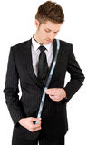 Business man using a measuring tape Royalty Free Stock Images