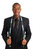 Business man using a measuring tape Royalty Free Stock Photos