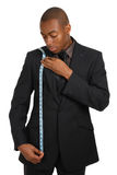 Business man using a measuring tape Stock Photography