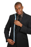 Business man using a measuring tape Stock Photo