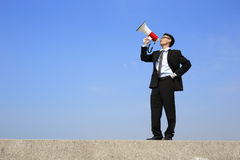 Business man using megaphone Royalty Free Stock Image