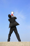 Business man using megaphone. Happy business man using megaphone shouting with blue sky background, asian Stock Image