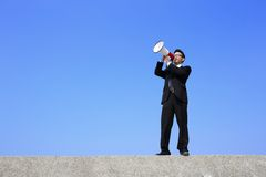 Business man using megaphone Royalty Free Stock Images