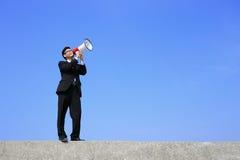 Business man using megaphone Stock Photo