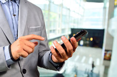 Business Man using Mobile Cell Phone in The Modern office buildi Stock Photo