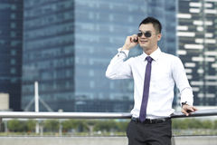 Business man using a Mobile Phone Stock Photography