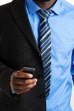 Business man using mobile phone. This is an image of a business man using his phone Stock Photo