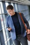 Business man using mobile phone app in airport royalty free stock photography