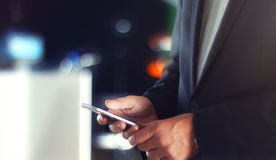 Business Man using Mobile Phone in Office Royalty Free Stock Photography