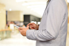 Business Man Using Mobile Tablet in Modern Business Building. Royalty Free Stock Photography
