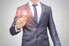 The business man using modern visual technology for trading to sell in stock market. Royalty Free Stock Photo