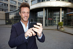 Business man using navigation app. In smartphone in urban city Stock Photography