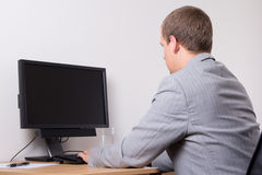 Business man using personal computer at work Stock Images