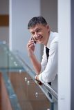 Business man using phone Stock Photo