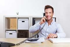 Business man using phone in office Royalty Free Stock Photography
