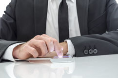 Business man using a smart phone Stock Photography