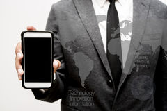 Business man using smart phone double exposure with business gra. Phics Royalty Free Stock Photography