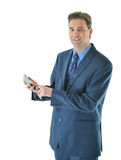 Business man using smart phone. Business man holding a smart phone looking straight Royalty Free Stock Photo