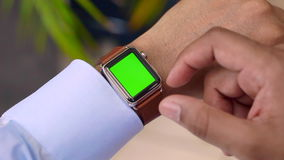 Business' man using smart watch mock-up. Business' man using smart watch green screen mock-up stock footage
