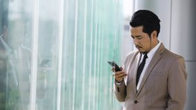 Business man using a smartphone in office stock video footage