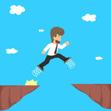 Business man using spring on the feet, jump over the gorge, the. Risk Royalty Free Stock Photography