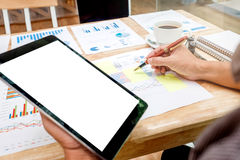 Business man Using tablet blank screen with Report chart Stock Photo