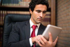 Business man using a tablet Royalty Free Stock Image