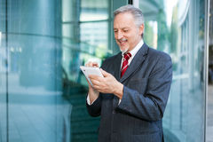 Business man using a tablet Royalty Free Stock Photos