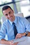 Business man using tablet compuer at office Royalty Free Stock Images