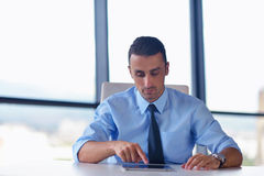 Business man using tablet compuer at office Stock Photography