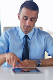 Business man using tablet compuer at office Stock Photo