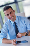 Business man using tablet compuer at office Royalty Free Stock Photography