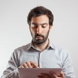Business man using a tablet computer Stock Image