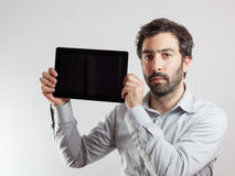 Business man using a tablet computer Stock Images