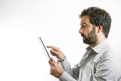 Business man using a tablet computer Stock Photography