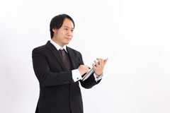 business man using tablet computer reading Stock Photo