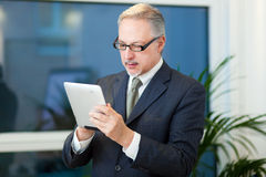 Business man using a tablet Royalty Free Stock Photo