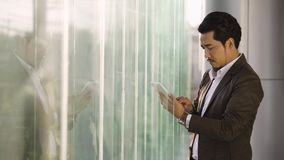 Business man using tablet in office. Young business man using tablet in office stock footage