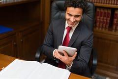 Business man using a tablet Stock Photos