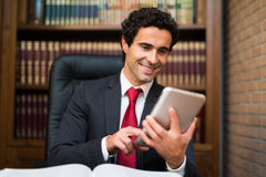 Business man using a tablet Stock Photography