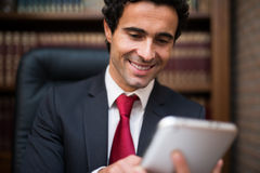 Business man using a tablet Royalty Free Stock Images